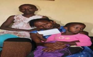 Muchai driver's wife Teresia Wanjiku and her two children Joy Wamboi,11 and Angelinet Wanjiru,4 at their Huruma house (PHOTO; JENIPHER WACHIE)