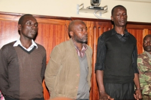 FROM LEFT: James Omondi alias Castro, Wycliffe Walibwa and Paul Otieno in a Nairobi court where they were sentenced to death for the murder of former Embakasi MP Mugabe Were. [Photo: Fidelis Kibunyi/Standard]