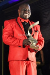 Actor Gerald Langiri pose for a picture with a trophy he won as the best supporting actor in a TV drama, during the Kalasha awards 2014. PHOTO: PIUS CHERUIYOT Read more at: https://www.standardmedia.co.ke/article/2000150818/gerald-langiri-on-risqu-role-piracy-and-future-projects/